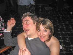 A drunk woman cuddling a drunk man