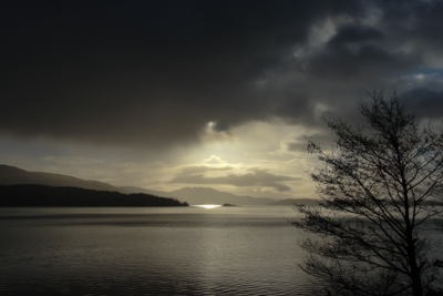 A picture of a sunset over a Scottish loch