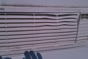 A fridge vent on a camper, buckled and twisted with heat