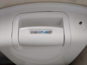 Manual flush on a Thetford chemical toilet
