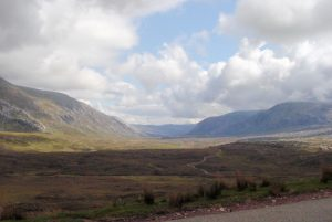 A photo of a moorland and mountain scene