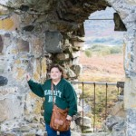 Tari Thompson fulfills her lifelong dream and touches the stone of her ancestral home.